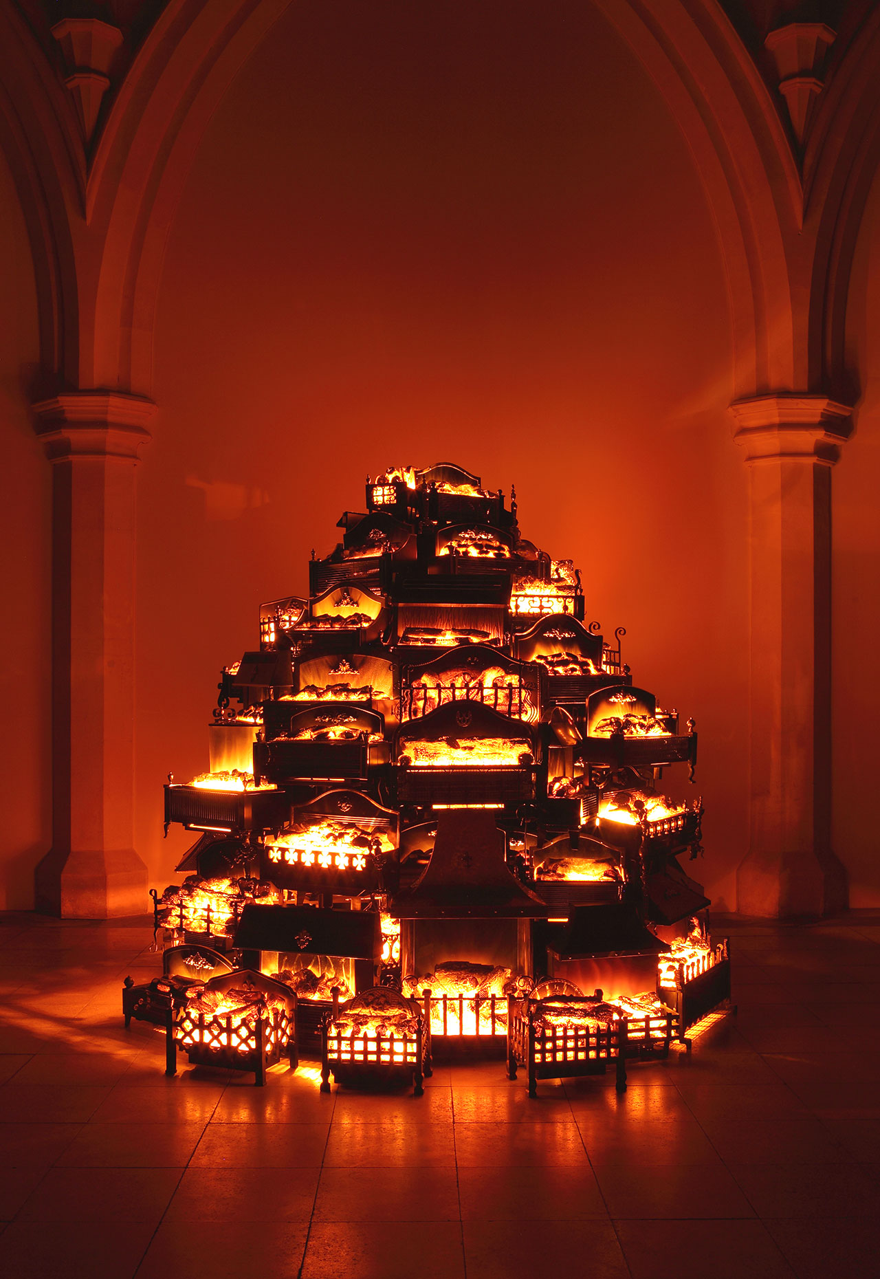 Stuart Haygarth, Pyre, 2006. Kee Klamp steel framework, timber base and 70 vintage electric log effect fires. Created for the exhibition 'Day Dreaming With Stanley Kubrick' held at Somerset House, London. Photo courtesy of the artist.