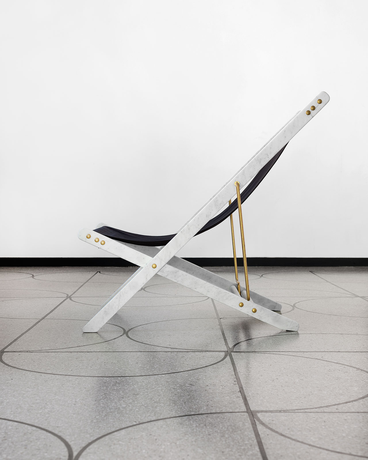 Veronica Todisco, Deck Chair for Camp, 2015. Carrara marble, fabric, brassed metal. Photo courtesy Camp Design Gallery.
