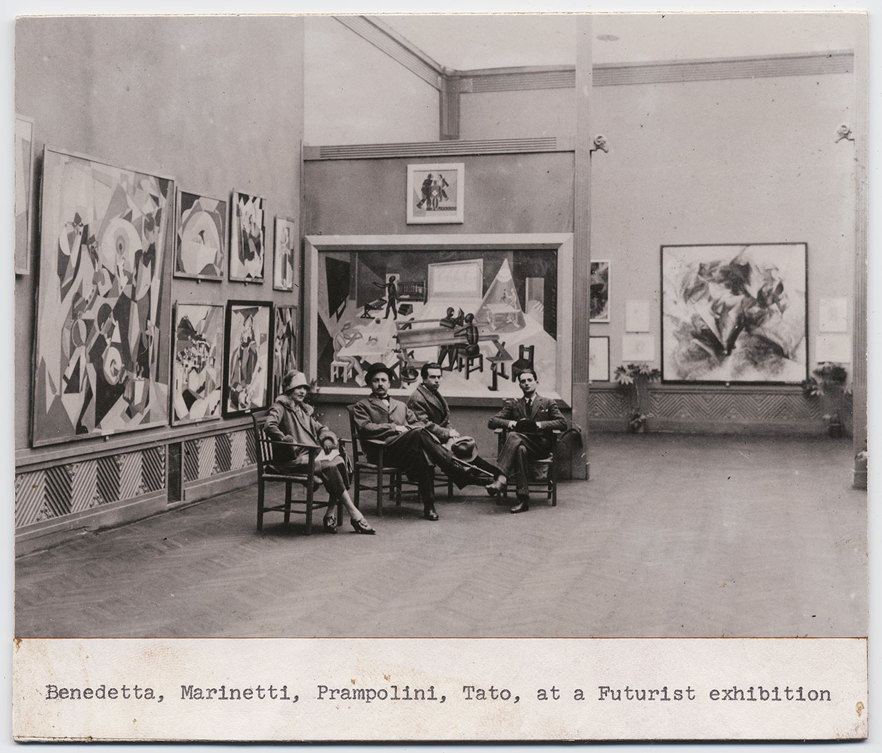 Benedetta Marinetti, Filippo Tommaso Marinetti, Enrico Prampolini and Tato at the Futurist exhibition in at Biennale di Roma in 1925. Among the exhibited works, Dinamismo di un footballer by Umberto Boccioni, 1913. Courtesy General Collection, Beinecke Rare Book and Manuscript Library, Yale University, New Haven.