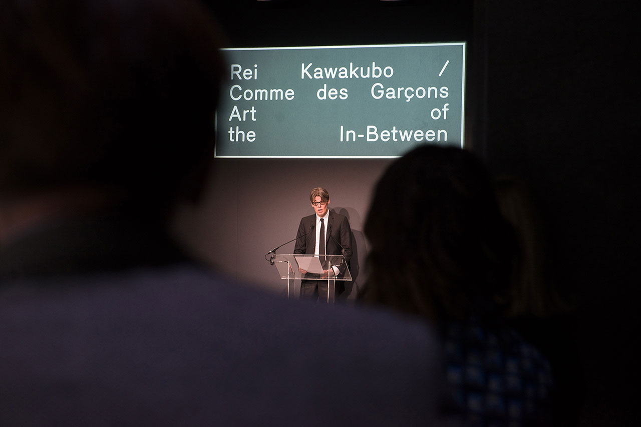 Andrew Bolton, Curator in Charge of The Costume Institute, speaks at The Met's Rei Kawakubo/Comme des Garçons: Art of the In-Between advance press event. Courtesy of The Metropolitan Museum of Art/BFA.com.
