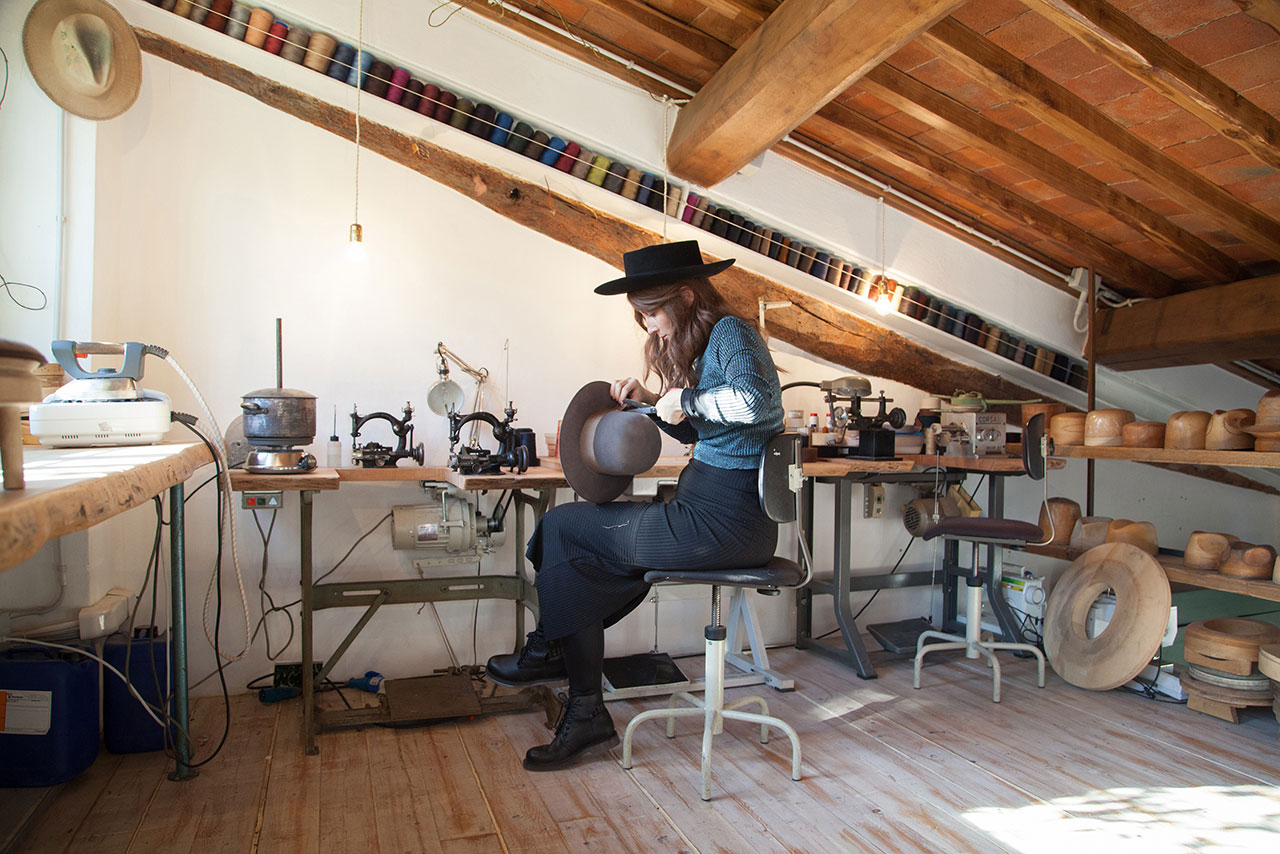 The techniques behind hat-making are decidedly old school: needle and thread, a bit of steam and a proper sewing machine. Photo by Michele Borzoni.