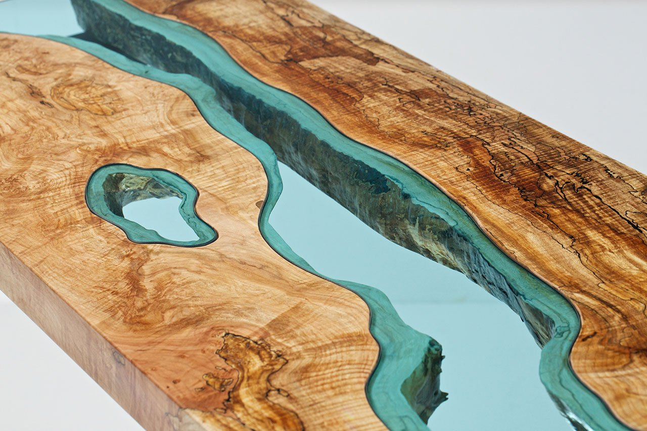 "Spalted Maple River Console (detail), richly-colored spalted maple slabs, modern black steel legs, hand-cut blue glass, silky smooth finish, 49"" x 18"" x 32"". Photo © Greg Klassen."