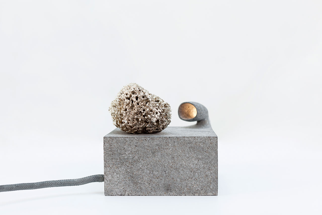 ROCK by Najla El Zein. Basalt, led, glass, sea sponge, silver. 14 x 14 x 13.5 cm.