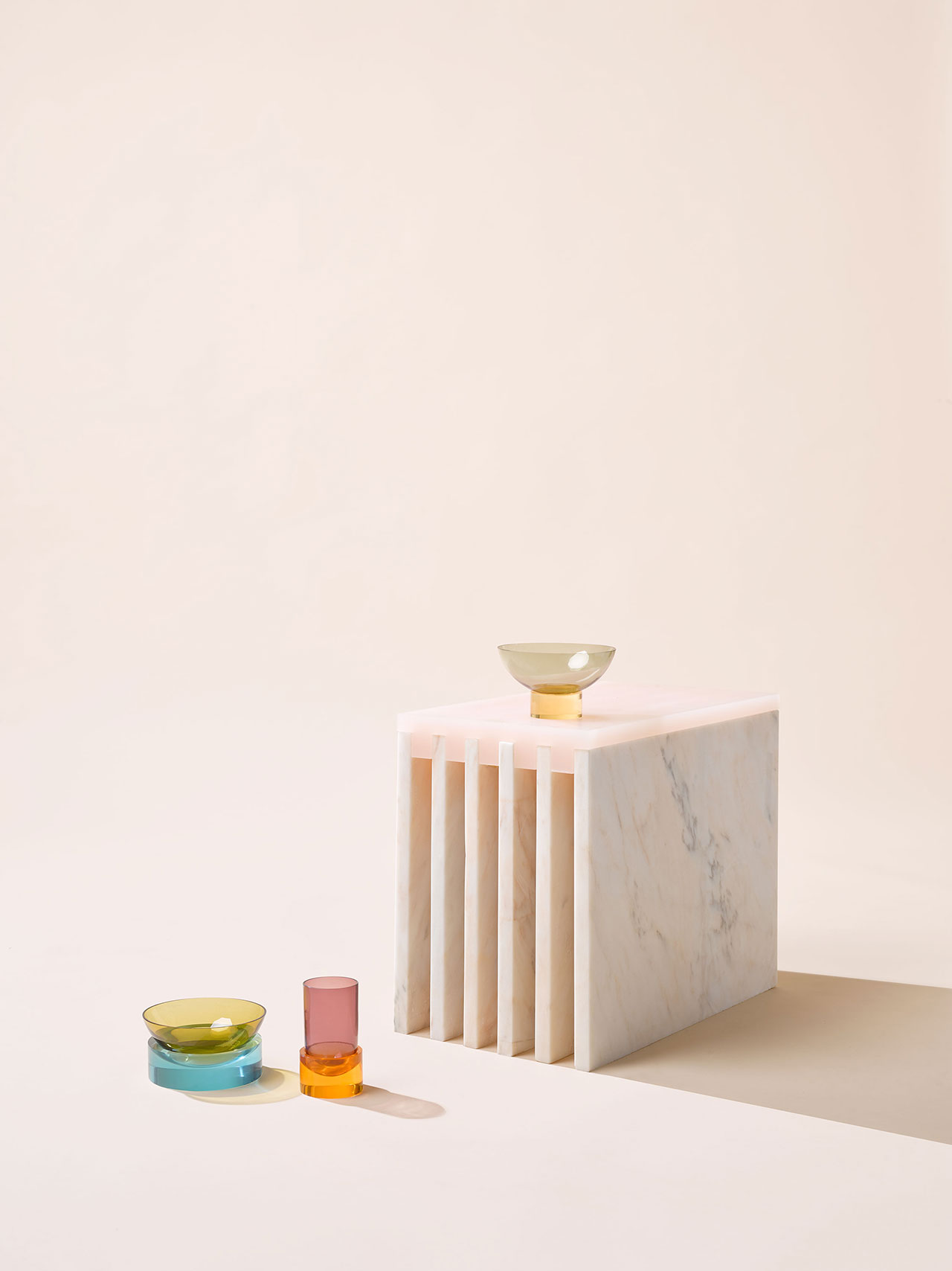 Objects of Common Interest, Side Table, 2016. Marble, Cast Acrylic. Relativity of Color glassware, 2017. Hand-blown Glass, Acrylic. Photo by Brooke Holm.