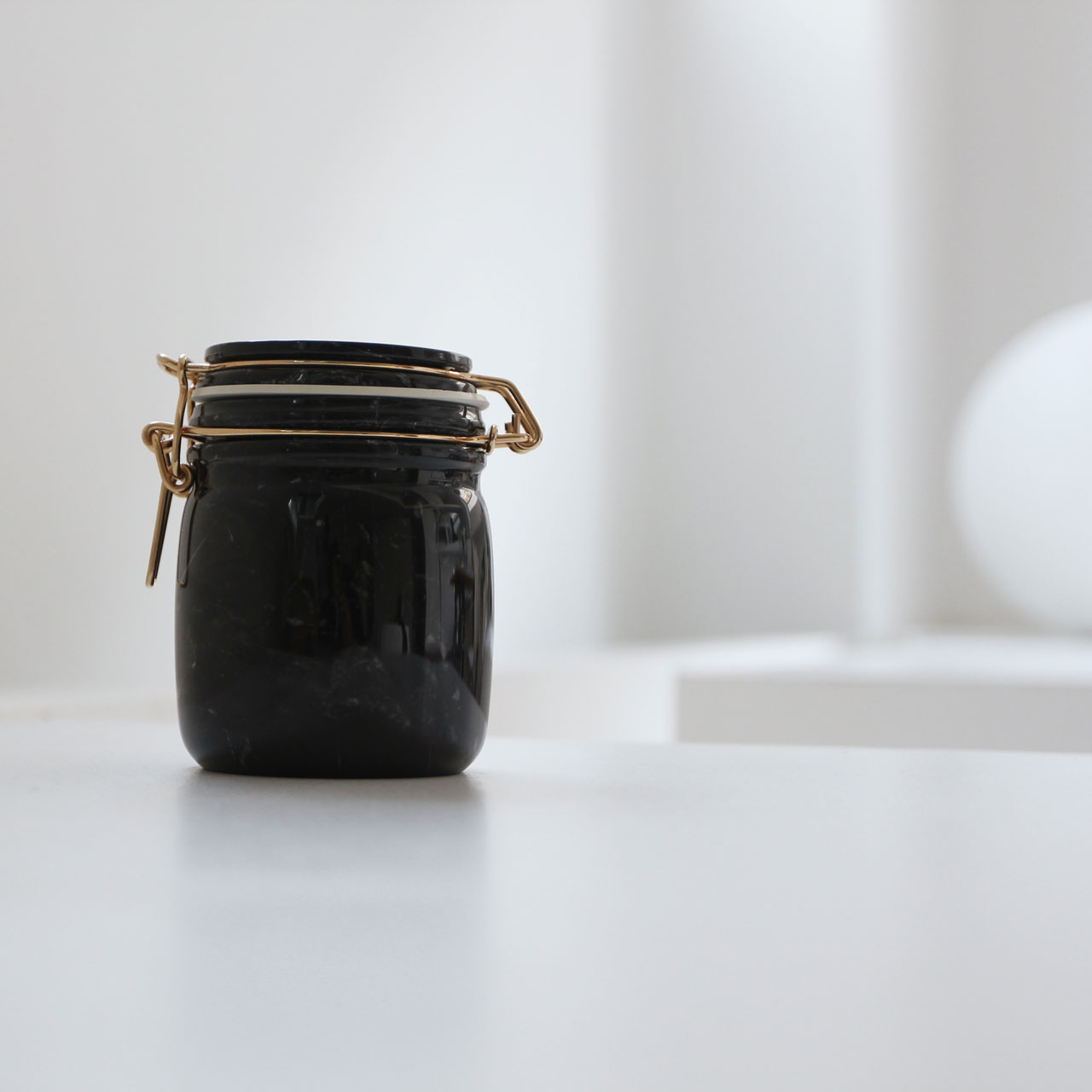 Mr. Marble jar by Lorenza Bozzoli for Spazio Pontaccio / Polished black Marquinia marble / Brass latch / 10 cm D x 12 cm H / Edition of 20. Photo by Costas Voyatzis.