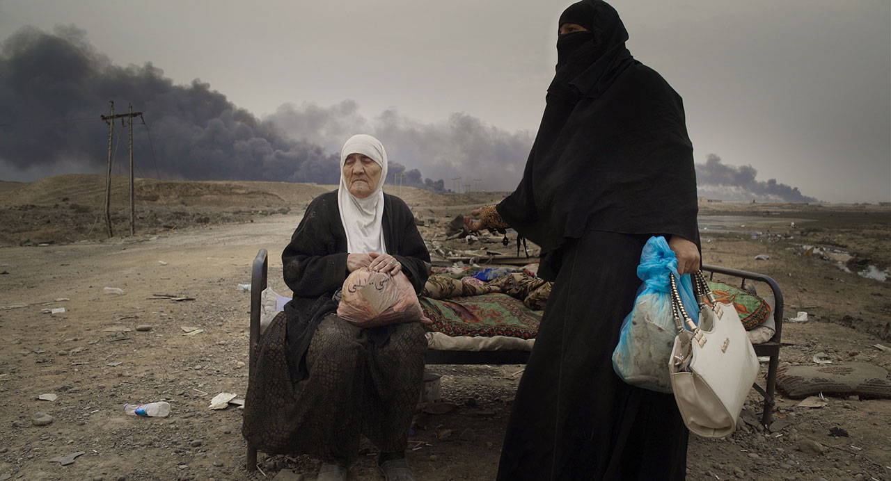 Two women pictured in Mosul, Iraq. From HUMAN FLOW, an Amazon Studios release. Photo courtesy of Amazon Studios.