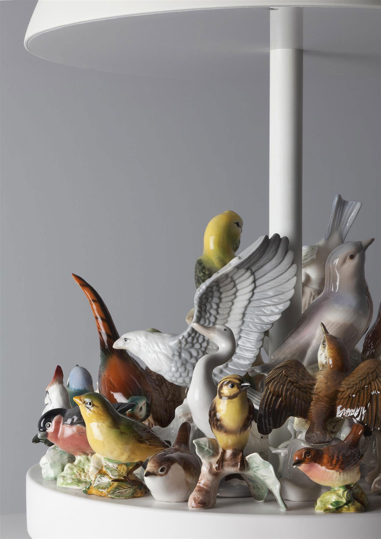 Stuart Haygarth, Island, 2016. Corian, Spun Metal Shade and Ceramic Birds Figurines. Photo courtesy Carpenters Workshop Gallery.