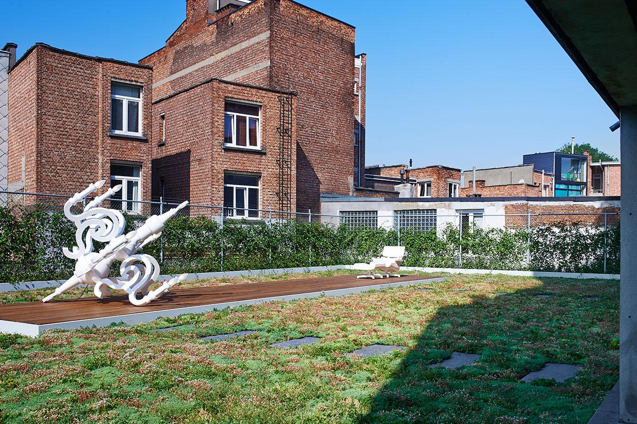 Roof.Chandelier Aluminium casted Chandelier, Studio Job, 2012.Relax Chair: MAL 1956, Bob Copray & Niels Wildenberg, 2011.Photo by Dennis Brandsma.