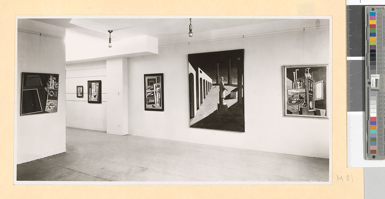 "Installation view of ""Giorgio De Chirico, Exhibition of Early Paintings"", Pierre Matisse Gallery, New York, 1940. Among the exhibited works: La nostalgie de l'ingénieur (1916) - For the work © Giorgio De Chirico by SIAE 2018 Pierre Matisse Gallery New York, N.Y. archives, 1903-1990, Box 100The Morgan Library & Museum. MA 5020. Gift of the Pierre Matisse Foundation, 1997. 3. 205567v_0534 Black-and-white editorial."