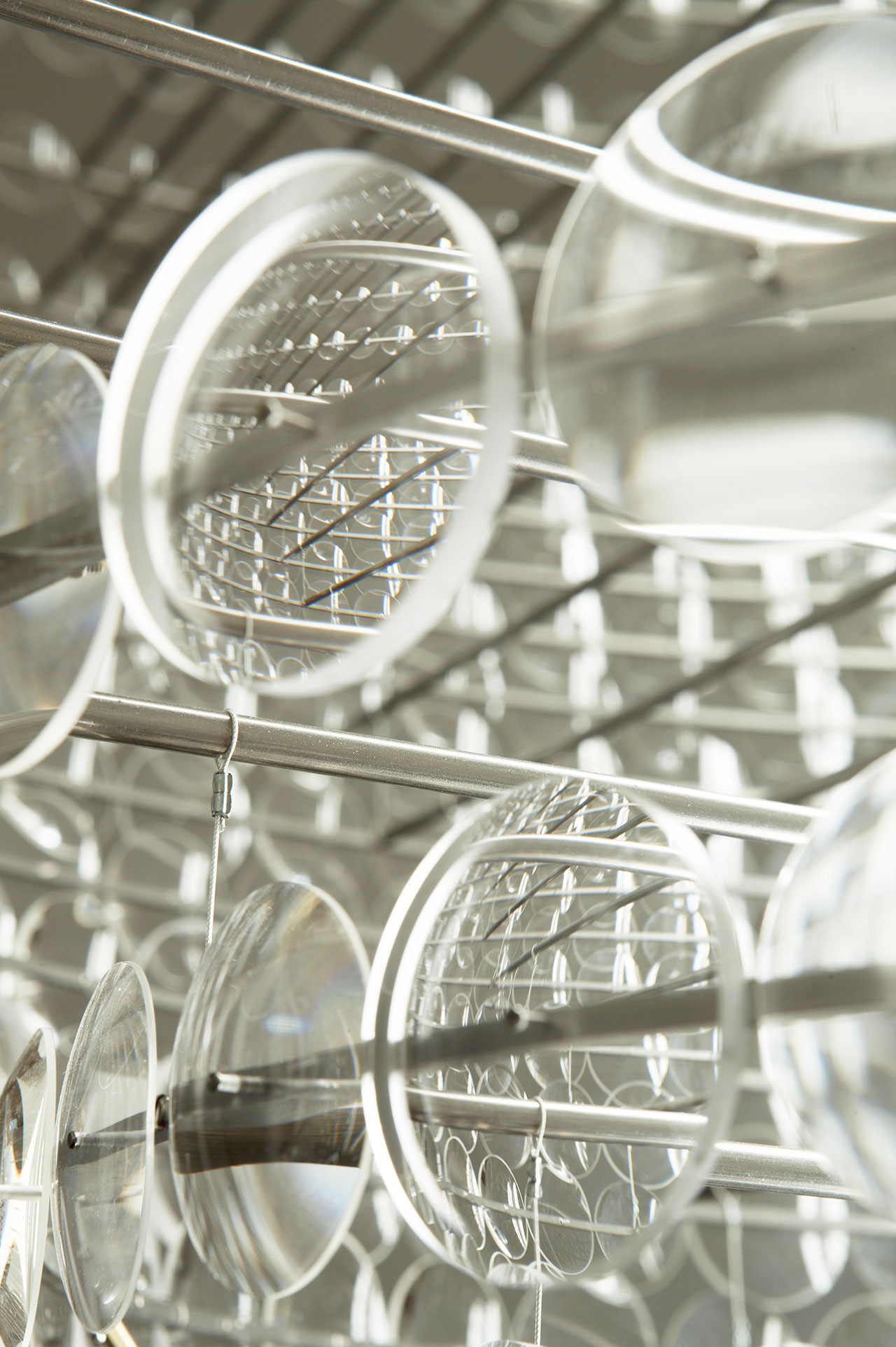 Stuart Haygarth, Magoo, 2009. Clear uncut lenses, stainless steel framework, micro cable, architectural tubes. Named after the iconic 1950's cartoon character Mister Magoo. Photo courtesy of the artist.