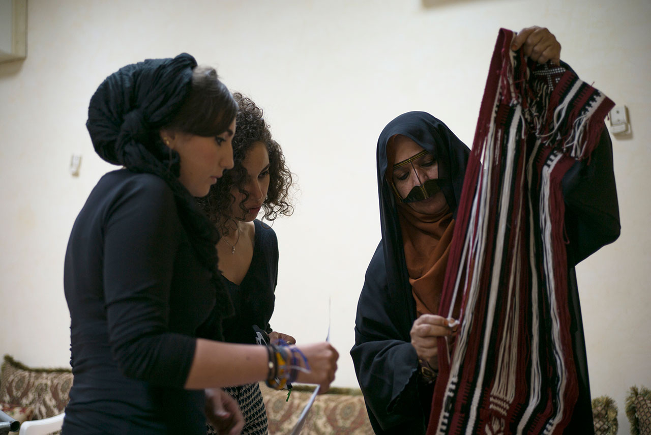 Mentalla Said and Jumana Taha of Studio MUJU working with a master weaver for the creation of the custom fabric used in their Fattoum floor lamp and Moza chair. Photo courtesy Tashkeel and the designers.