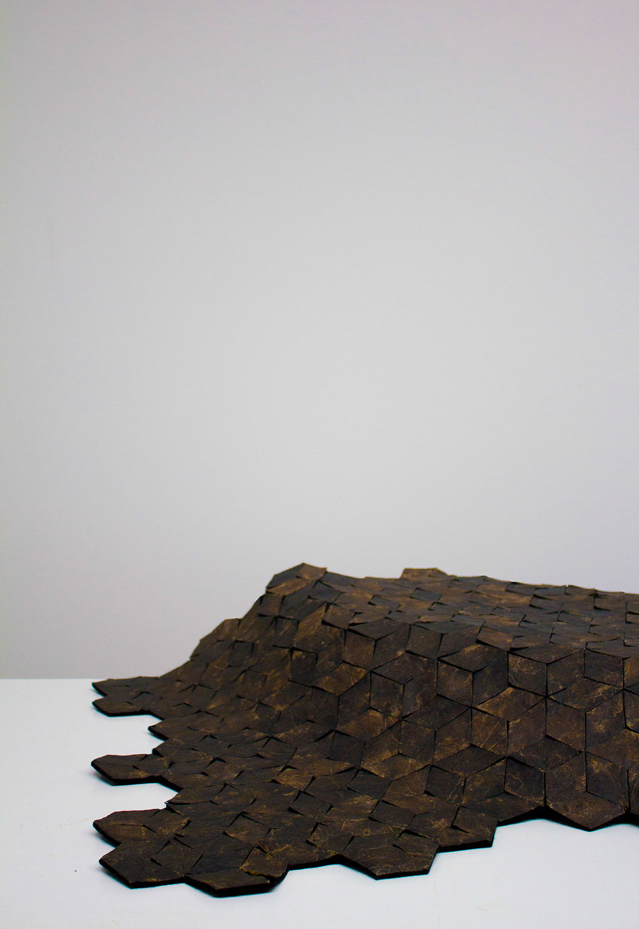 Marlène Huissoud, From Insects, Silk rug. Hundred of lozenges made out of the 'Wooden Leather', assembled together to create a flexible surface. Photo by Yesenia Tibault Picazo.