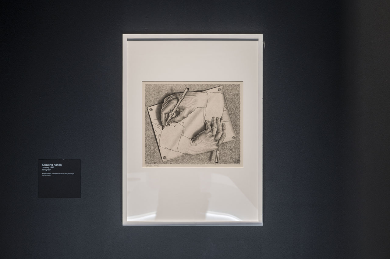 Installation view of M.C. Escher, Drawing hands, at Escher x nendo | Between Two Worlds, on display at NGV International from 2 December 2018 – 7 April 2019 © The M. C. Escher Company, the Netherlands. All rights reserved. Photo by Eugene Hyland.