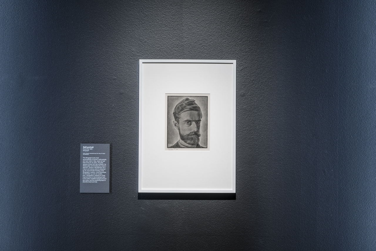 Installation view of M.C. Escher, Self-portrait, at Escher x nendo | Between Two Worlds, on display at NGV International from 2 December 2018 – 7 April 2019 © The M. C. Escher Company, the Netherlands. All rights reserved. Photo by Eugene Hyland.