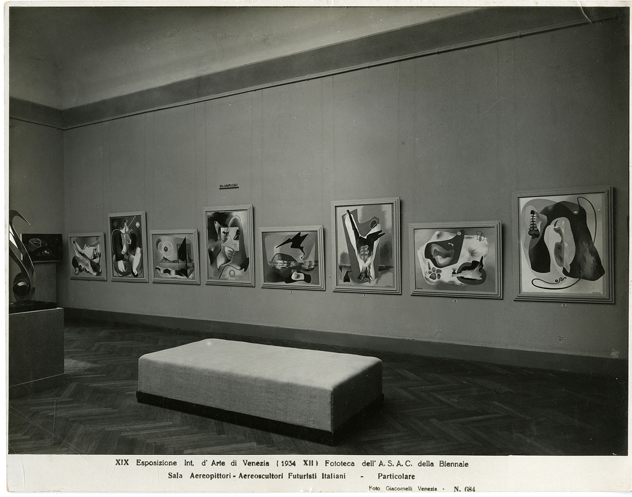 "Aeropittori room of XVIII Biennale, Venezia, 1934 Among the exhibited works, I funerali del romanticismo: trasfigurazione estetica (1934) by Enrico Prampolini © The Venice Biennale, ASAC, Photo Library - ""Attualità e Allestimenti"" series - Particular Room. Aereopittori, Aereoscultori Futuristi Italiani, XIX. International Art Exhibition 1934. Photo Giacomelli."