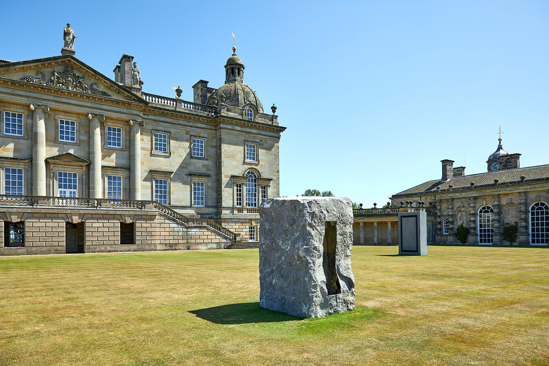 Exhibition view, Anish Kapoor at Houghton Hall. © Anish Kapoor. All rights reserved DACS, 2020. Photo by Pete Huggins. Featured: Untitled, 1997, Kilkenny limestone. Courtesy the artist. Rectangle Within a Rectangle, 2018, granite. Courtesy the artist and Lisson Gallery.
