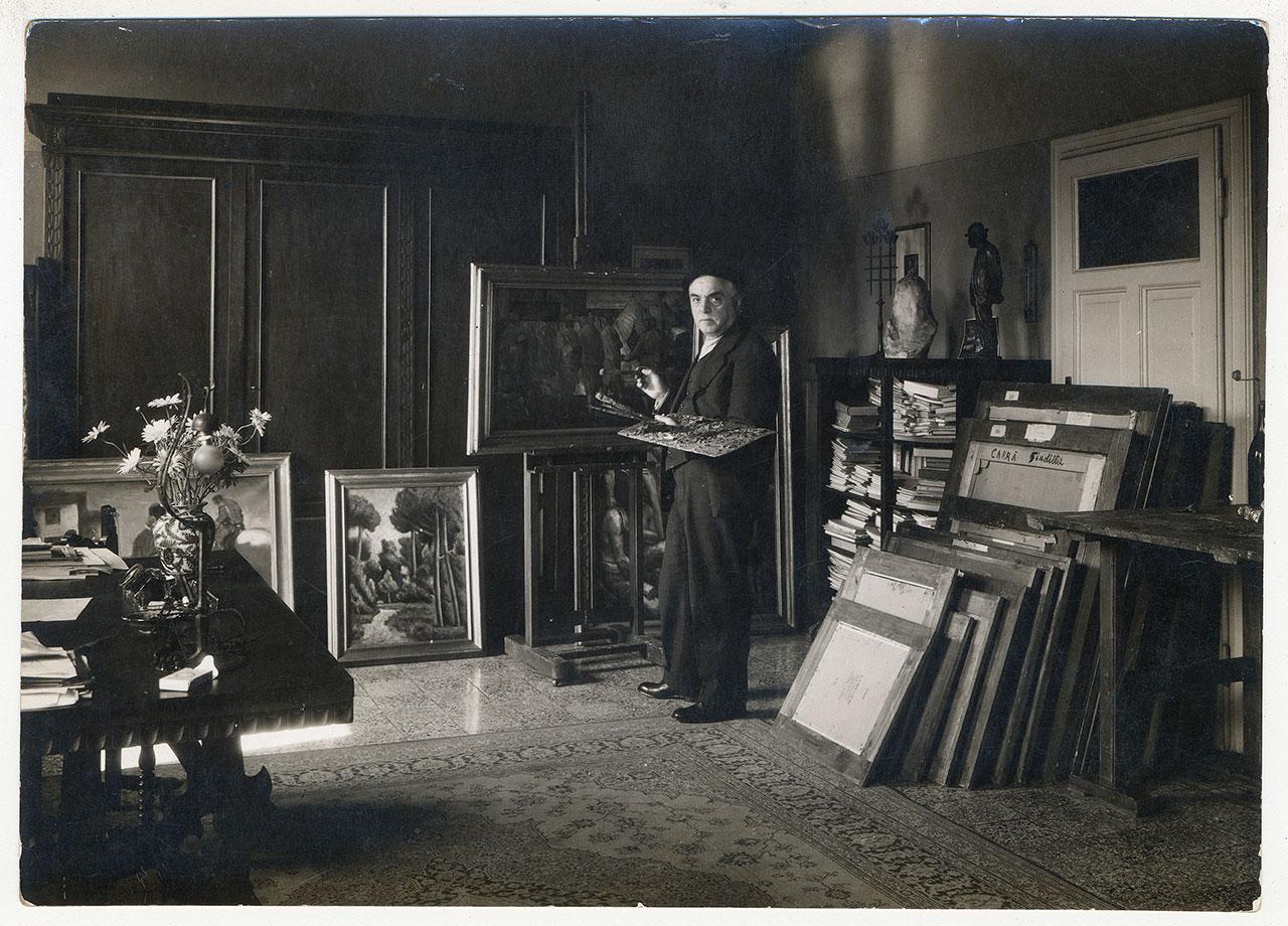 Carlo Carrà in his Milanese studio (via Pascoli 18), 1934. ArchiveCarlo Carrà © Carlo Carrà by SIAE 2018.