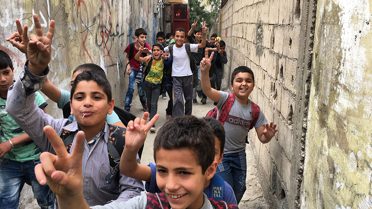 A group of children run through Ain al-Hilweh, the largest Palestinian refugee camp in Lebanon. From HUMAN FLOW, an Amazon Studios release. Photo courtesy of Amazon Studios.