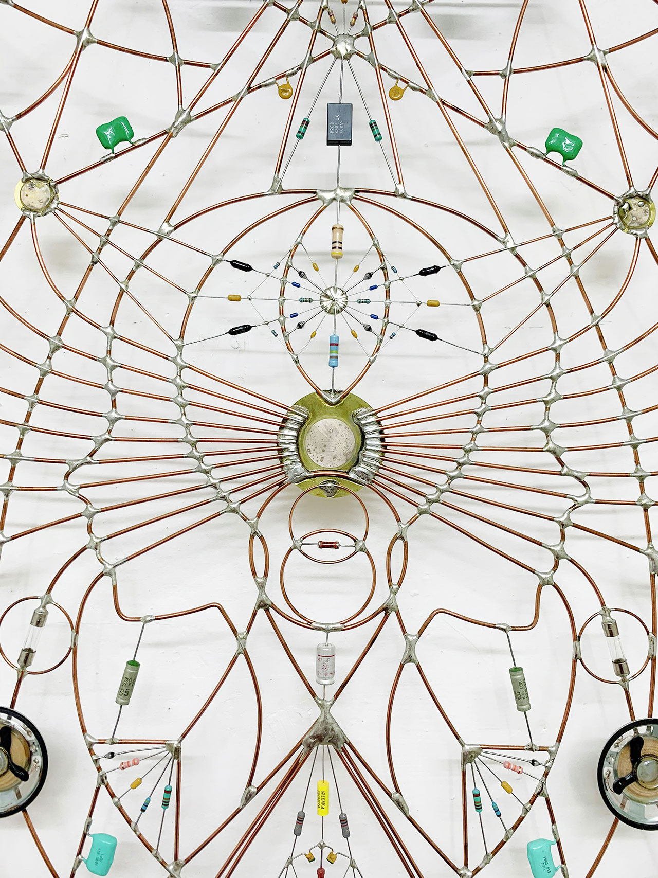 Technological mandala 91 - Come in alto così in basso (close up), 2016. Stainless steel bed frame, springs, Copper wires, electronic components, microchip, speaker, varnish, 195x82x4 cm | 76¾x32¼x1½ inches. Courtesy: The Flat – Massimo Carasi. Photo by The Flat.