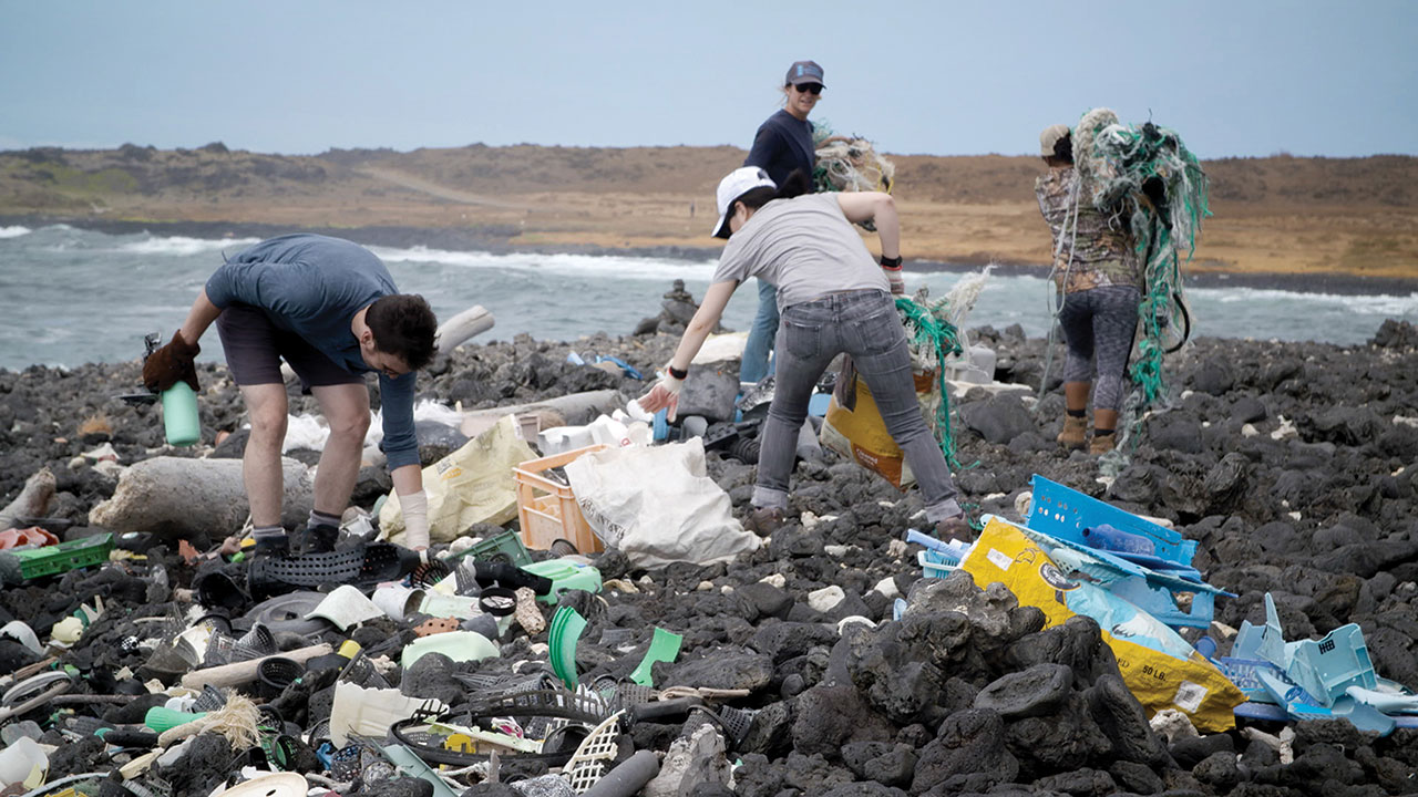 Jason Klimoski and Lesley Chang of StudioKCA collecting plastic in Hawaii. Photo by Alejandro Duran.