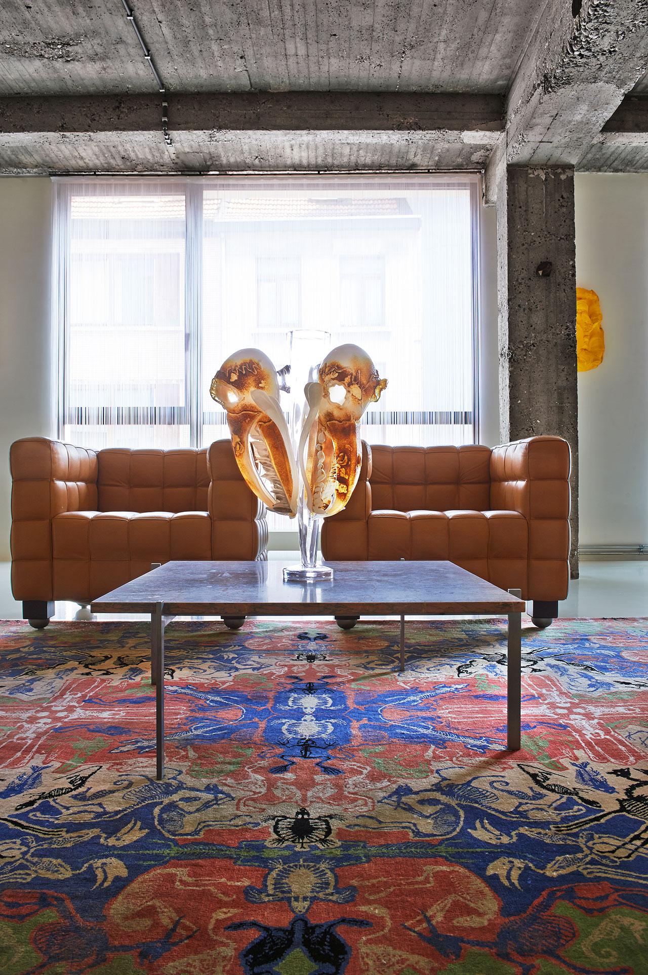 Living room. Carpet: Perished, Studio Job for Nodus, 2010. Coffee table: PK 61 Poul Kjaerholm, 1956. Vase: Boris Sipek, 2000.Bank: Cube, Joseph Hoffmann, 1910.Bronze: Diamond, Studio Job, 2002.Painting: Yellow, Bram Bogart, 2007.Photo by Dennis Brandsma.