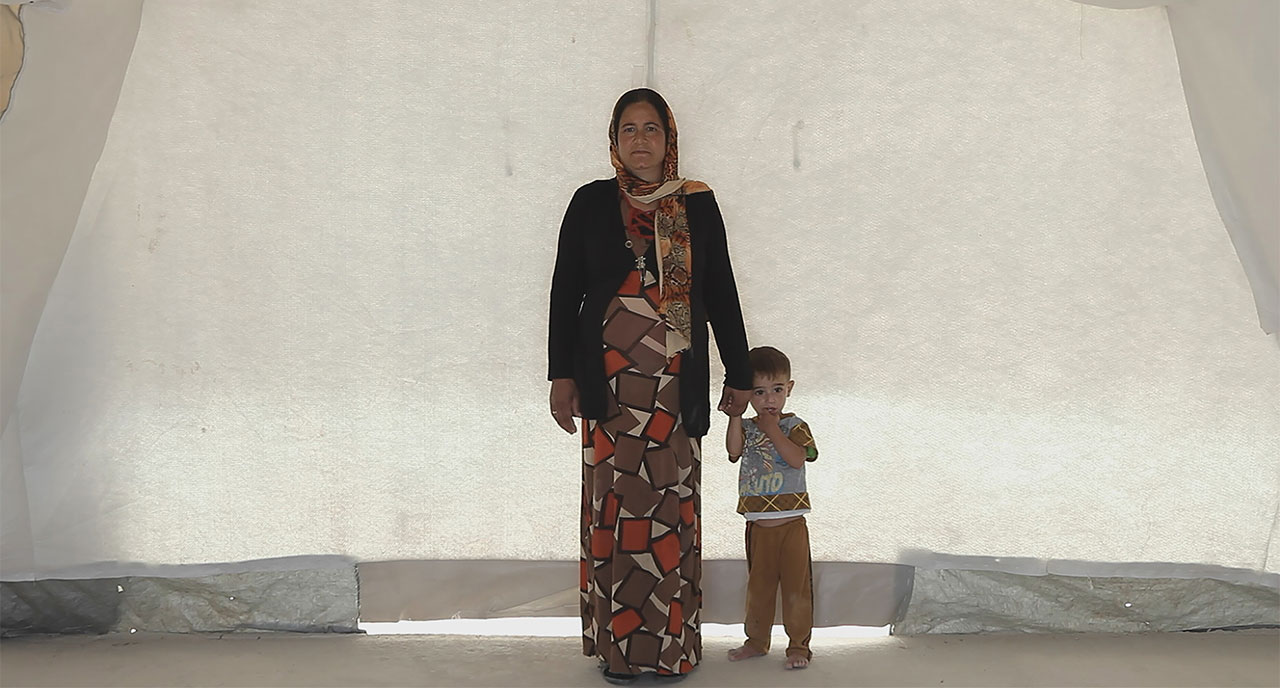 Mother and son in Shariya Camp, Iraq. From HUMAN FLOW, an Amazon Studios release. Photo courtesy of Amazon Studios.