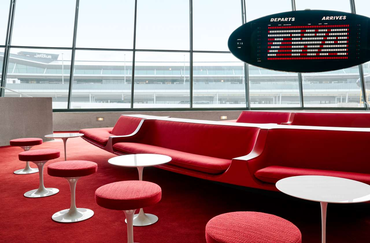 The Sunken Lounge at the TWA Hotel features Chili Pepper Red carpet and authentic penny tile. Courtesy of TWA Hotel. Photo by David Mitchell.