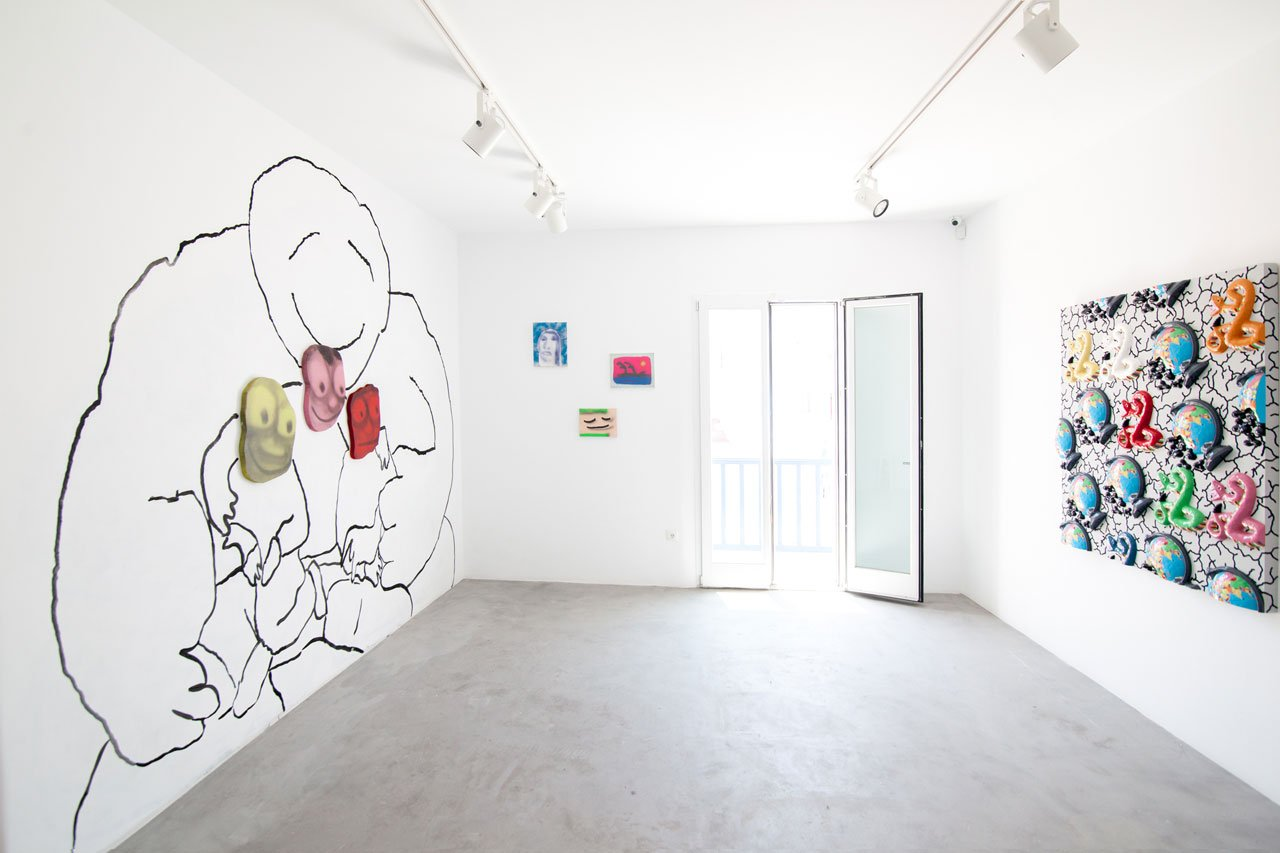 Greek Gotham, curated by Maria Brito. Installation view. Left: Mural and paintings by Austin Lee. Right: Seven Snakes, by Matthew Palladino. Photo by Peter Koloff.