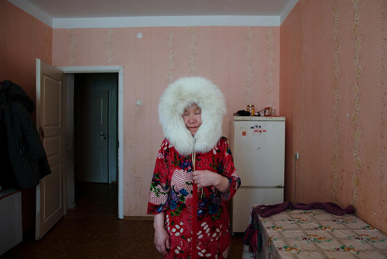Pudani Audi (born.1948). Yar-Sale, Yamalo-Nenets Autonomous Okrug, Russia. Pudani was born in the tundra and roamed since birth. In this portrait, she is wearing a fur hat, the sole object she was left with from her wandering days. Photo © Oded Wagenstein.