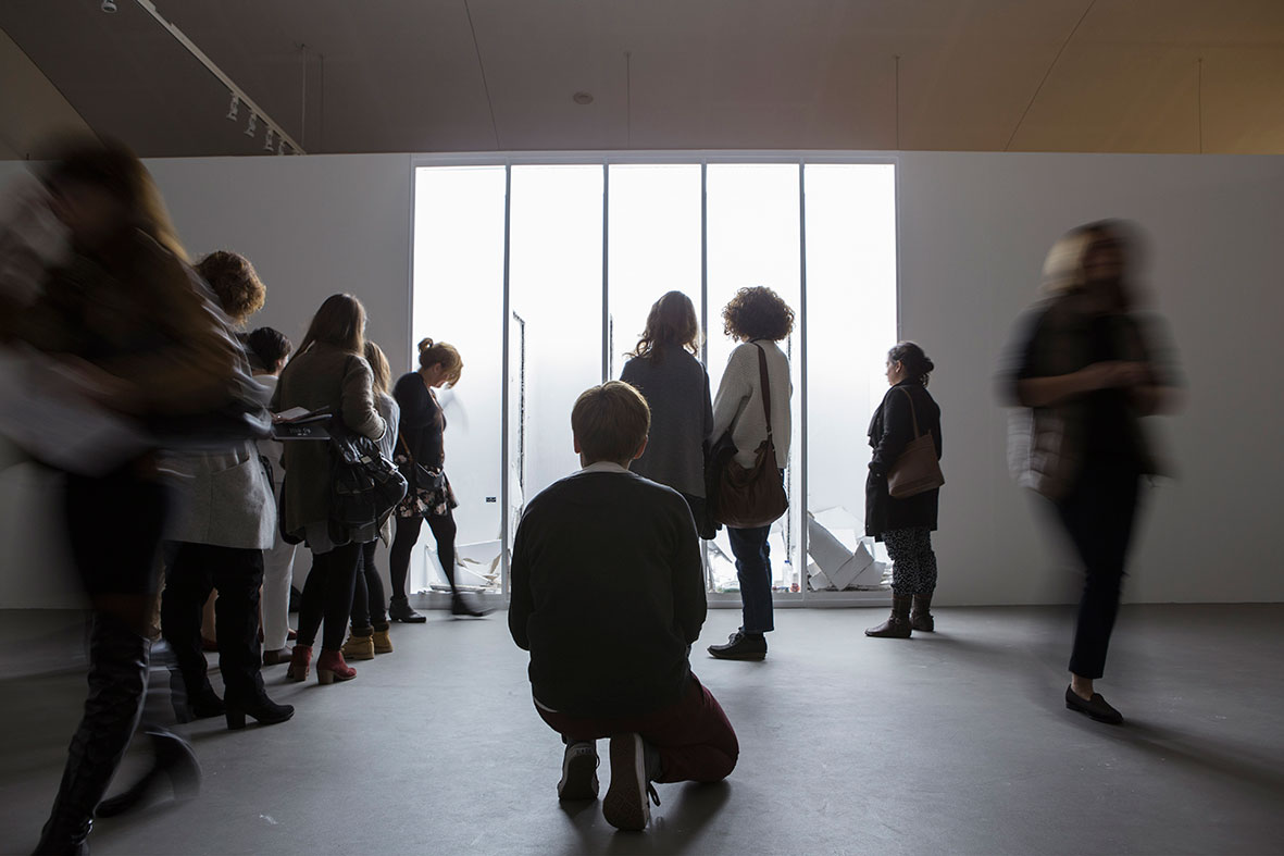 "Audience watching Yiannis Pappas performing ""A Key - Εκεί"". Part of AS ONE at the Benaki Museum in Athens, 2016. Exhibition design by AK-A architects. Photo © Natalia Tsoukalas."