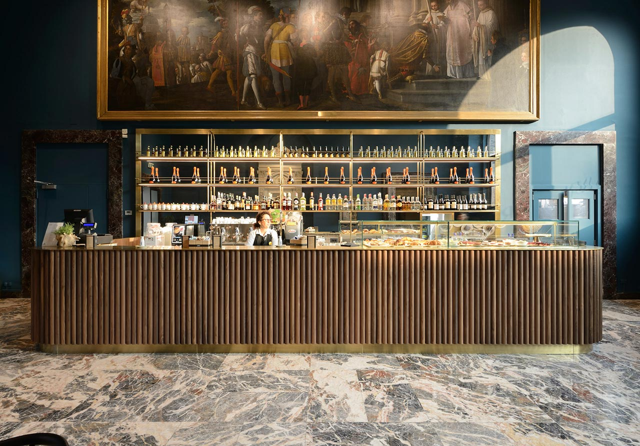 Photo by Michele Nastasi. Above the bar is Pietro Damini's expansive 17th century painting of 'St. Bernard Converting the Duke of Aquitania'