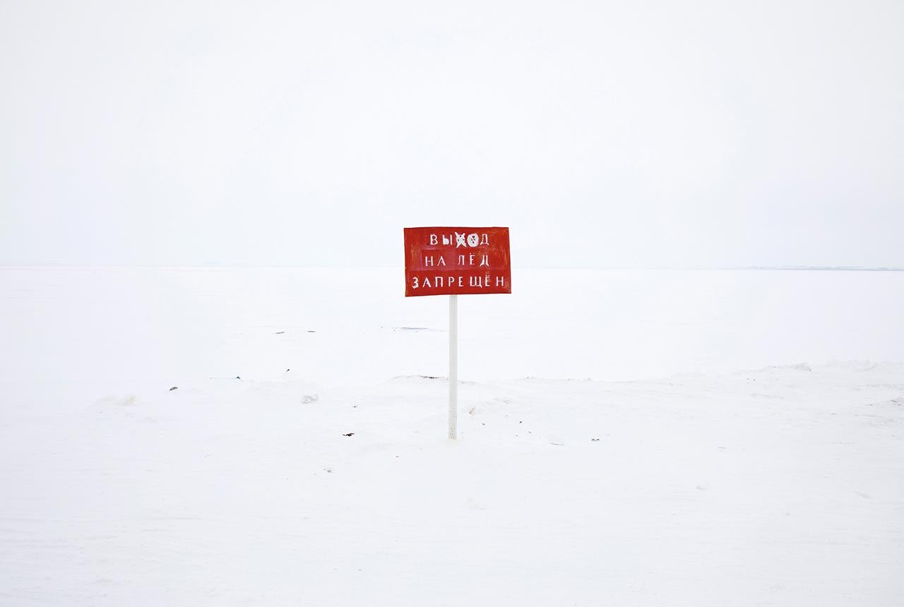 "An official sign warning the local villagers that ""going out to the ice is prohibited,"" meaning that from this point on, tundra begins. Yamalo-Nenets Autonomous Okrug, Russia. Photo © Oded Wagenstein."