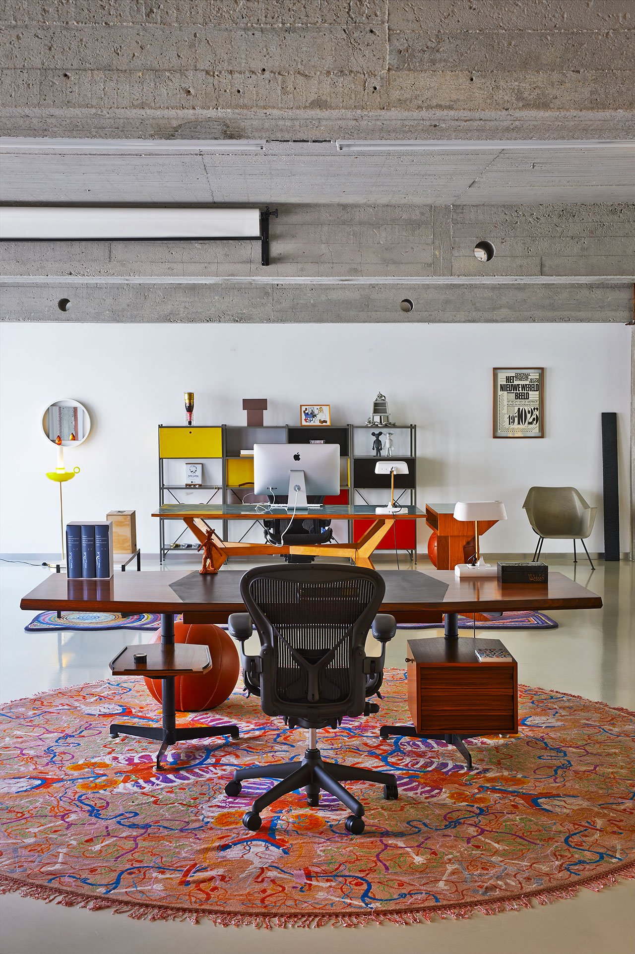 Studio.Chair: Aeron, Herman Miller. Desk: T96, Techno, Osvaldo Borsani, 1955.Carpet: Quack, Nodus, Studio Job, 2011.Desk lamp: Work, Tichelaar Makkum, the Dick Hoff, 2007.Pouf: Playtime, Montis, Studio Job, 2005.Mirror: DZ84, 't Spectrum, Benno, 1956.Lamp Candle Stick, Mae West, Venini, Studio Job, 2011. Cabinet: 663 Gispen, Wim Rietveld, 1954.Mice: Johan Peter Hol, 2003. Vase: mat, Cor Unum, Benno, 1993.Champagne Piper Heidsieck, Viktor & Rolf, 2007.Bucket seat: Gispen 416, Wim Rietveld & Andre Cordemeyer, 1955. Oak plank: smoke, Maarten Baas, 2007. Poster: Centraal Museum, Anthon Beeke, 1984.Photo by Dennis Brandsma.
