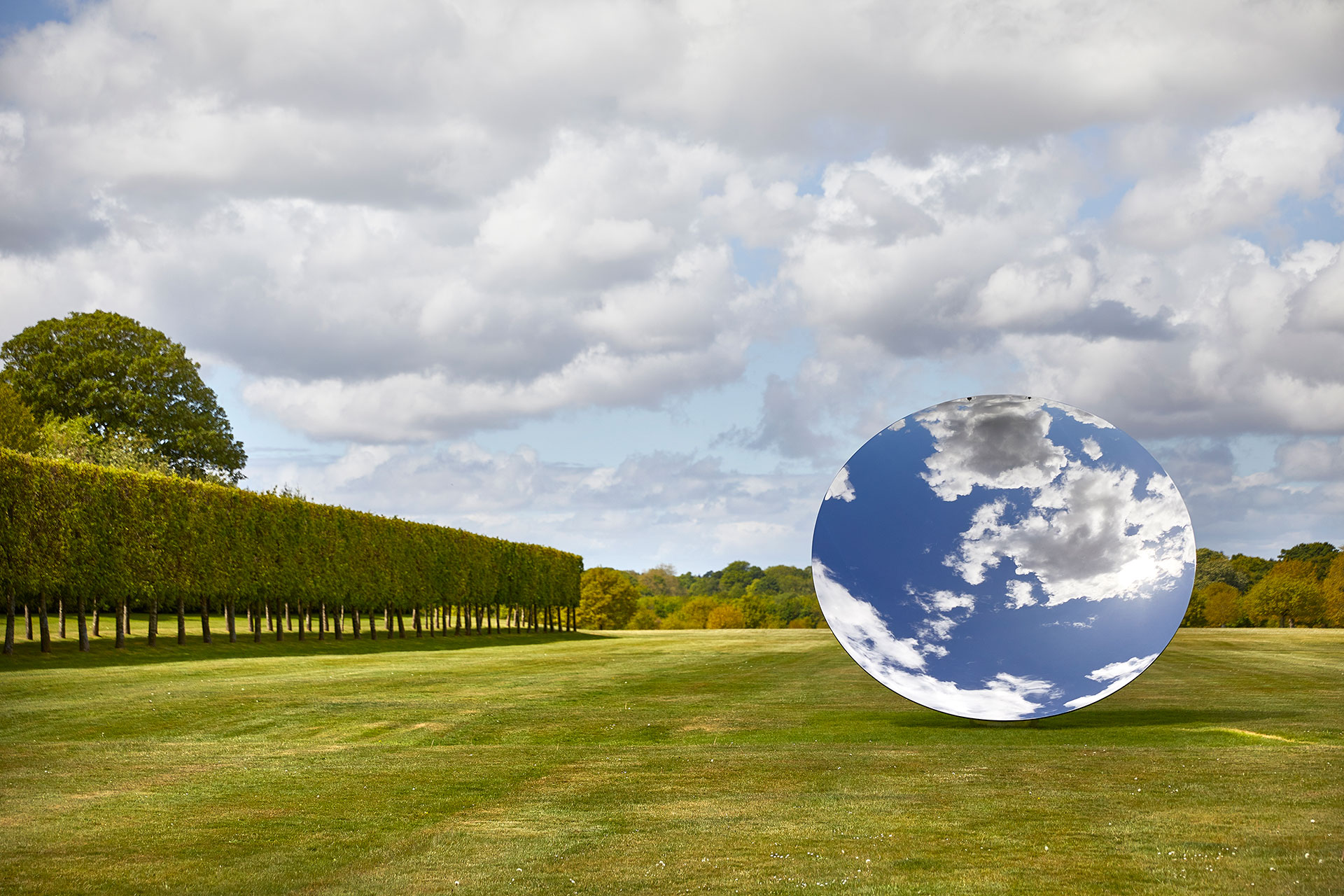 Exhibition view, Anish Kapoor at Houghton Hall. © Anish Kapoor. All rights reserved DACS, 2020. Photo by Pete Huggins. Featured: Sky Mirror, 2018, stainless steel. Courtesy the artist and Lisson Gallery.