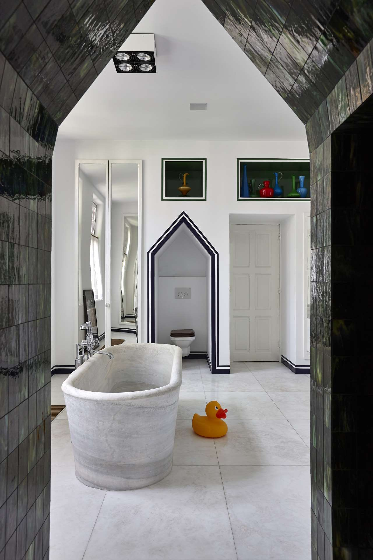 The remodeled bathroom of an Arts & Crafts townhouse is reminiscent of a Greek island. © JPDEMEYER&CO.