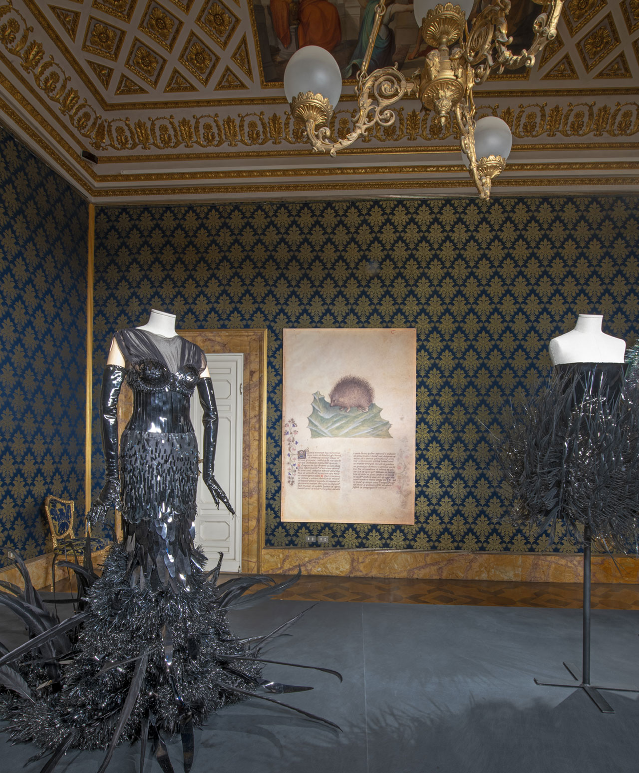 "Exhibition view (from left to right): On Aura Tout Vu, Dress""Jet lag"", Spring/Summer 2016 Couture. Iris van Herpen, Dress, Voltage Collection, Spring/Summer 2013 Couture. Photo © Antonio Quattrone."