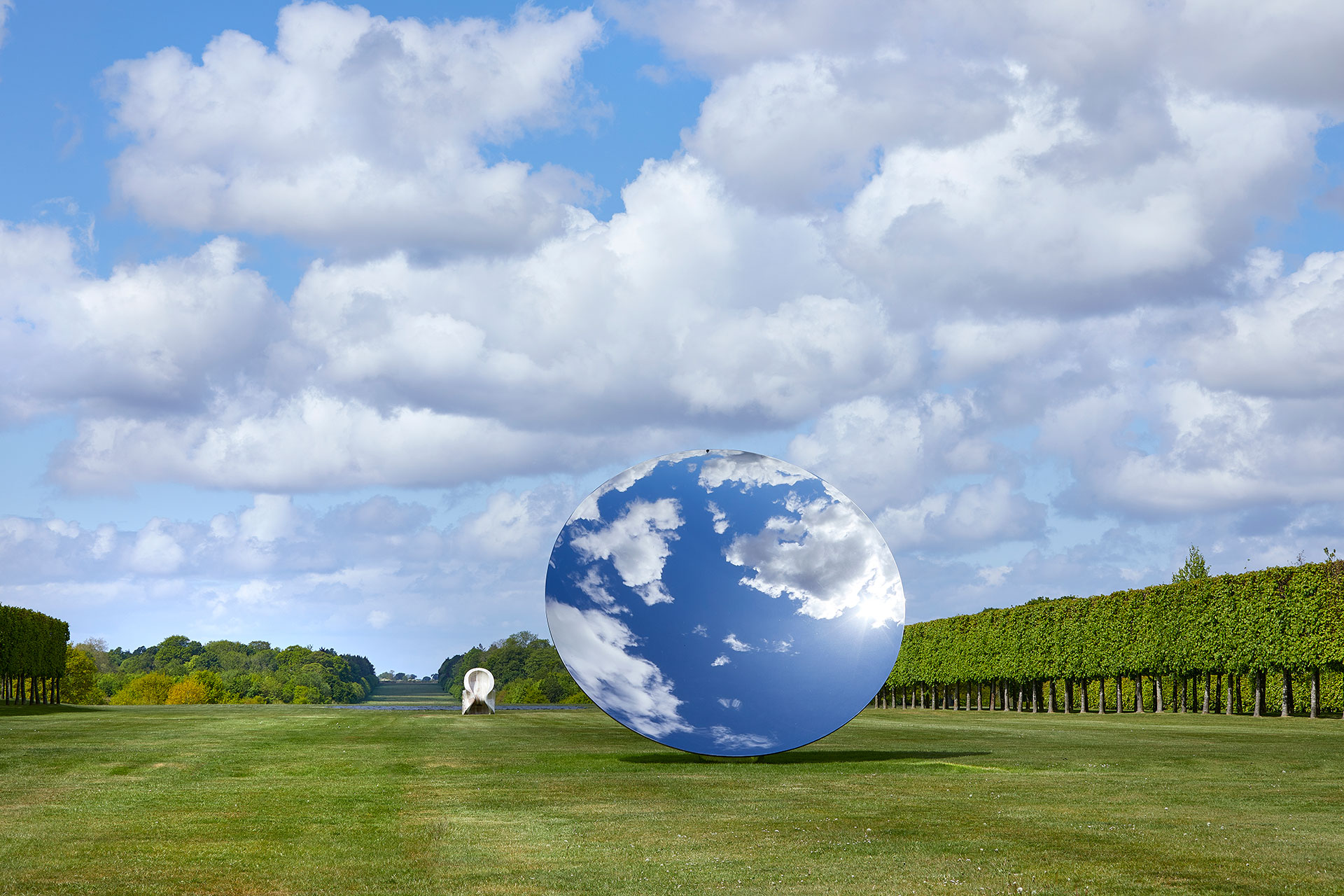 Exhibition view, Anish Kapoor at Houghton Hall. © Anish Kapoor. All rights reserved DACS, 2020. Photo by Pete Huggins. Featured: Sky Mirror, 2018, stainless steel. Eight Eight, 2004, onyx. Courtesy the artist and Lisson Gallery.