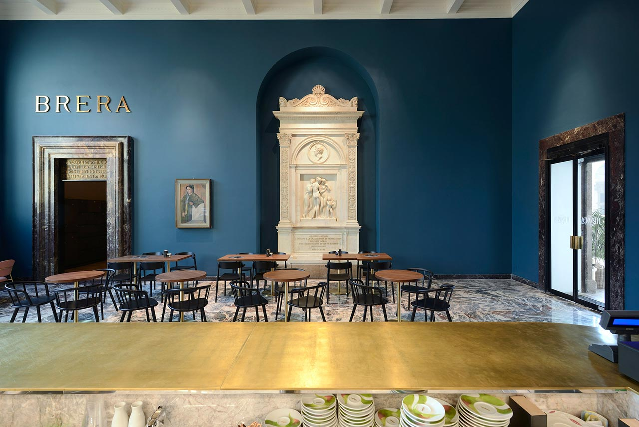 Bertel Thorvaldsen's marble monument to the painter Andrea Appiani (right) and a portrait of Fernanda Wittgens by Attilio Rossi (left). 'Nemea' & 'Nym' armchairs, 'Inox square' & 'Inox round' table, all by Pedrali. Photo by Michele Nastasi.
