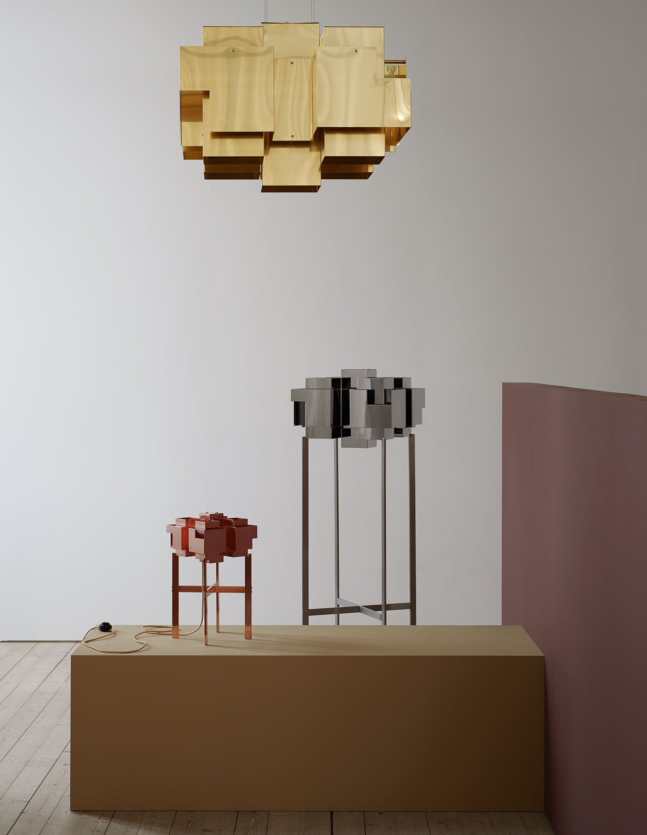 Lamp series Skyline, brass ceiling lamp, chrome floor lamp, copper table lamp, all by Folkform for Örsjö. Photo by Kristofer Johnsson.
