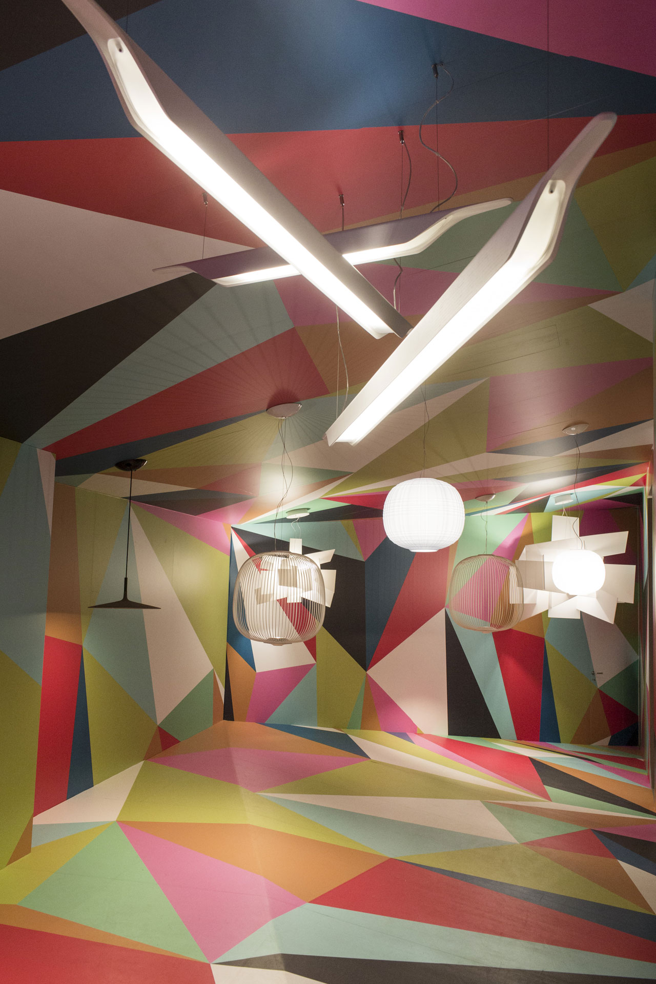 Designer/architect Ferruccio Laviani played with scale in an Alice in Wonderland-like installation of Foscarini lamps and their giant versions.