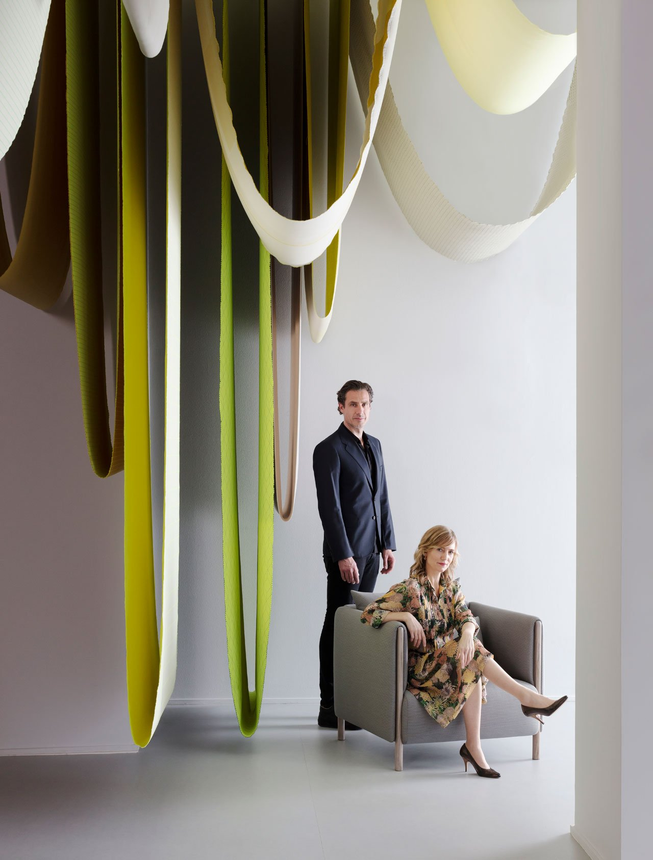 Chromatography exhibit by Stefan Scholten and Carole Baijings of Scholten & Baijings in the Herman Miller featuring Mahatma textiles that were hanging from the ceiling, and beneath them elements of their new ColourForm Sofa Group for Herman Miller.Photo by Ben Anders.