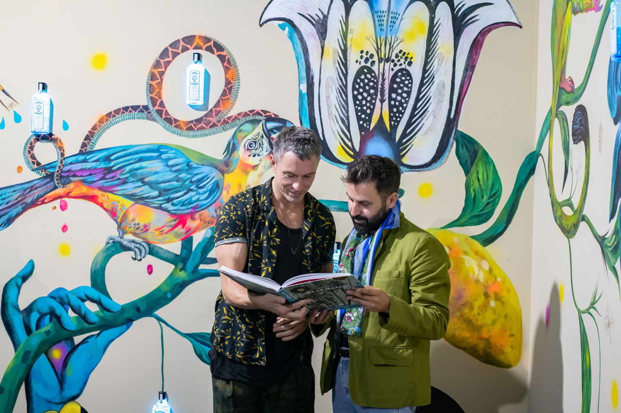 Olaf Hajek and Costas Voyatzisduring the CANVAS event by Bombay Sapphire, London, July2018. Installattion view by Elias Joidos © Yatzerland Ltd.