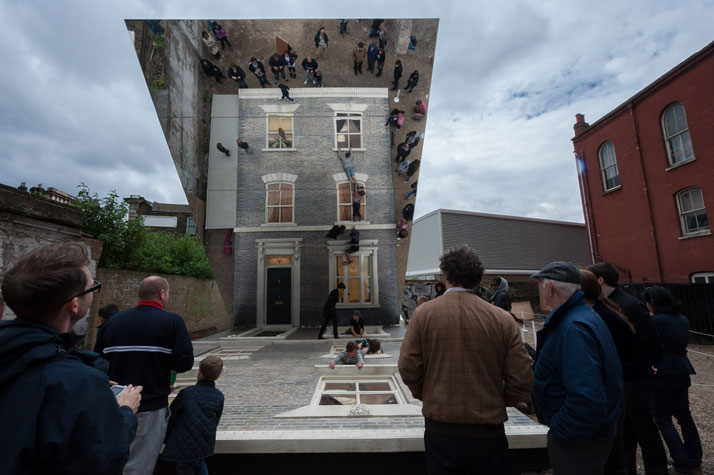 Visitors watch from outside the houseLeandro Erlich: Dalston HouseInstallation images© Gar Powell-Evans 2013 Courtesy of Barbican Art Gallery