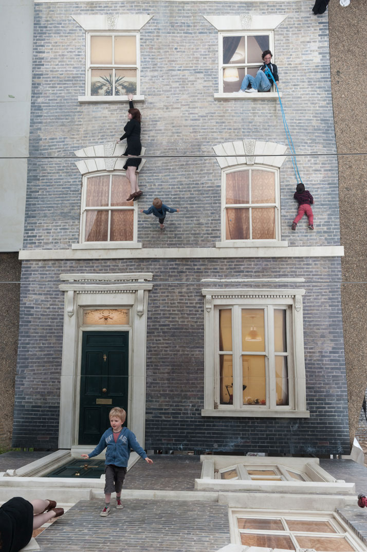 Visitors play with illusionLeandro Erlich: Dalston HouseInstallation images© Gar Powell-Evans 2013 Courtesy of Barbican Art Gallery