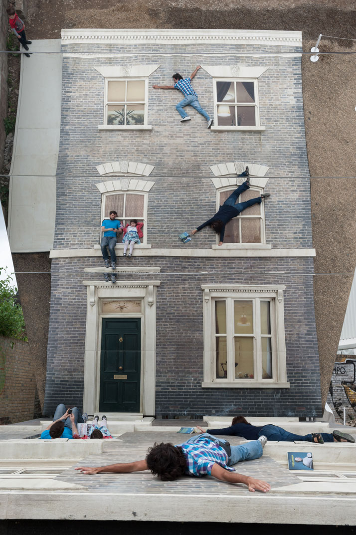 Visitors play with reflectionsLeandro Erlich: Dalston HouseInstallation images© Gar Powell-Evans 2013 Courtesy of Barbican Art Gallery