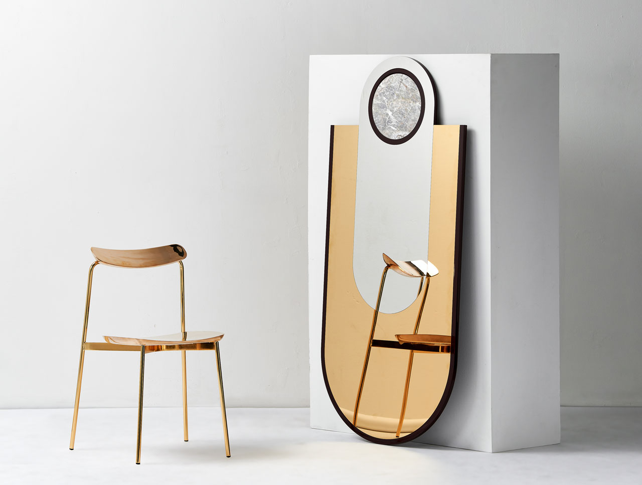 "A mirror from the ""Everything is Golden"" collection by Hava Studio and limited edition SIA chair by Tom Fereday were presented by Emma Elizabeth and LOCAL DESIGN, at the LOCAL MILAN exhibition of 26 Australian designers."