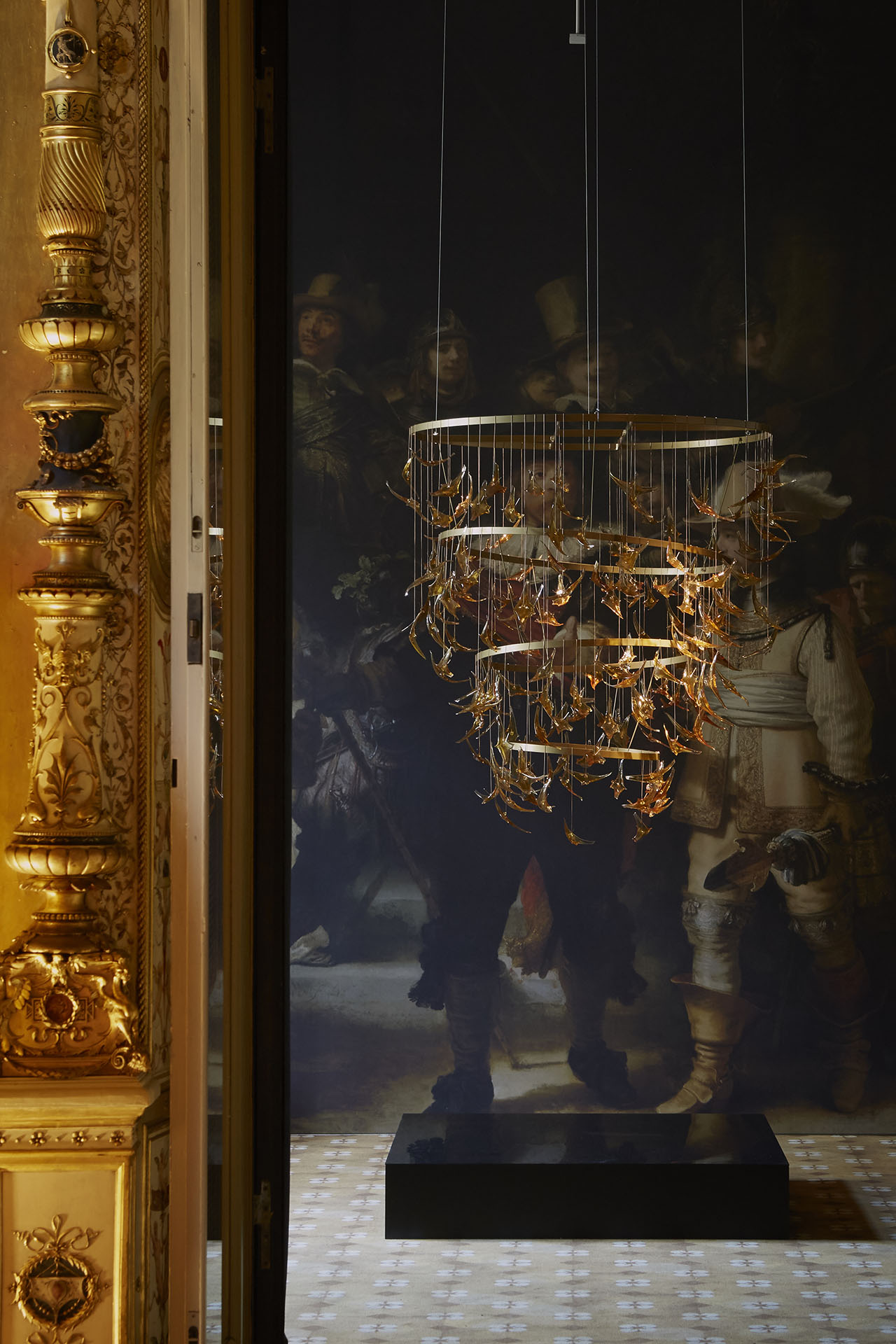 "Glass birds chandelier by Dutch glass artist Bibi Smit inspired by the colours of the ""NightWatch"" by Rembrandt. Installation view at Palazzo Francesco Turati as part of the ""Masterly- the Dutch in Milano"" exhibition. Photo by Laura Majolino."