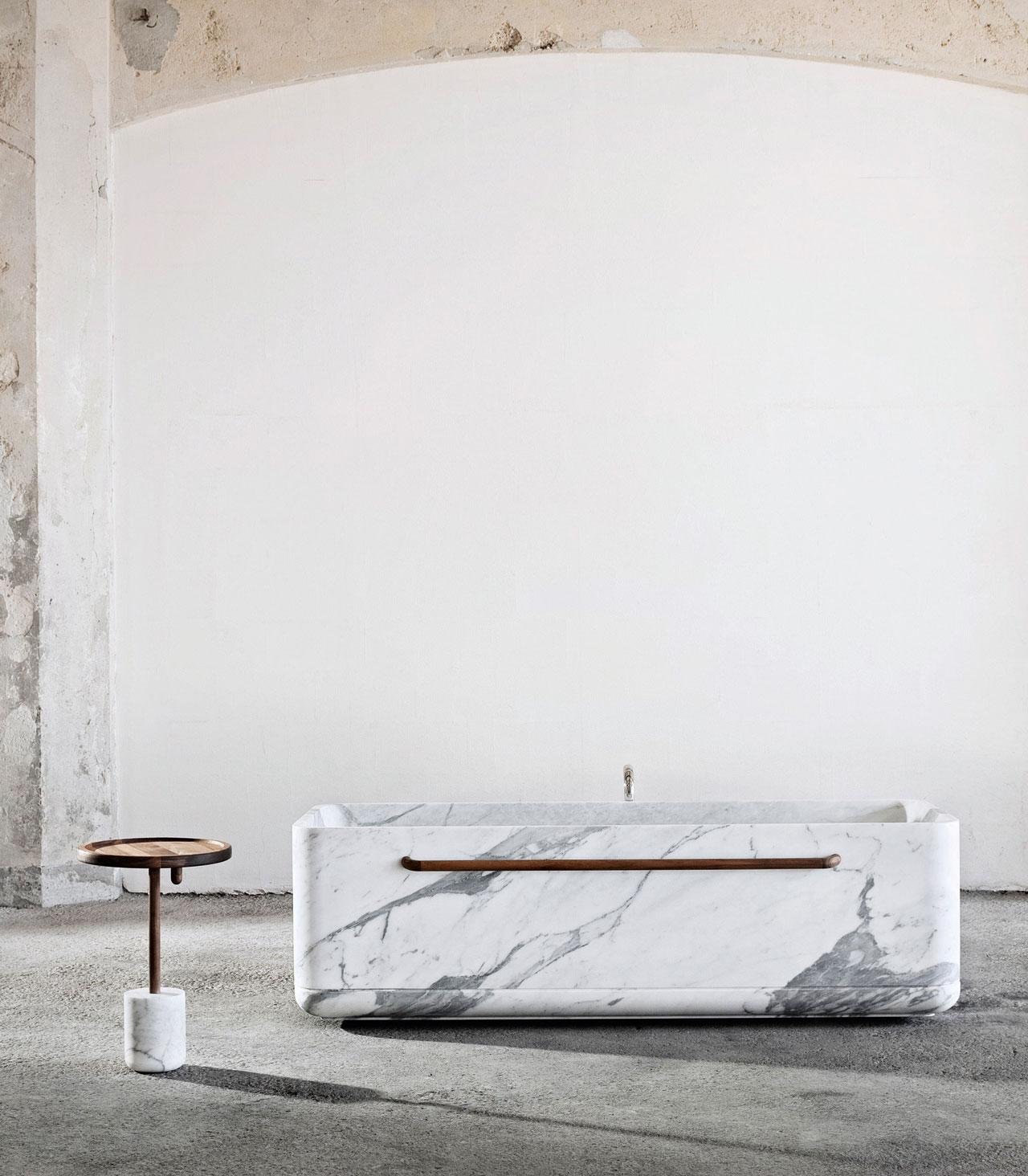 Tavolino side table and Vaska bath tub by Lorenzo Damiani from the MONOLITHOS series of Luce di Carrara.