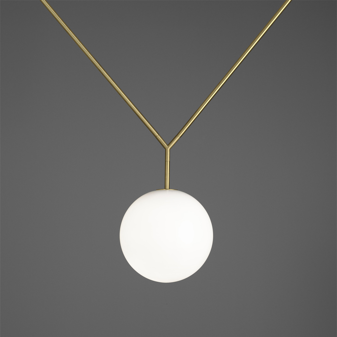 NOTCH byMichael Anastassiades for FLOS. Suspension lamp with adjustable height, regulated by varying the angle of the braces.