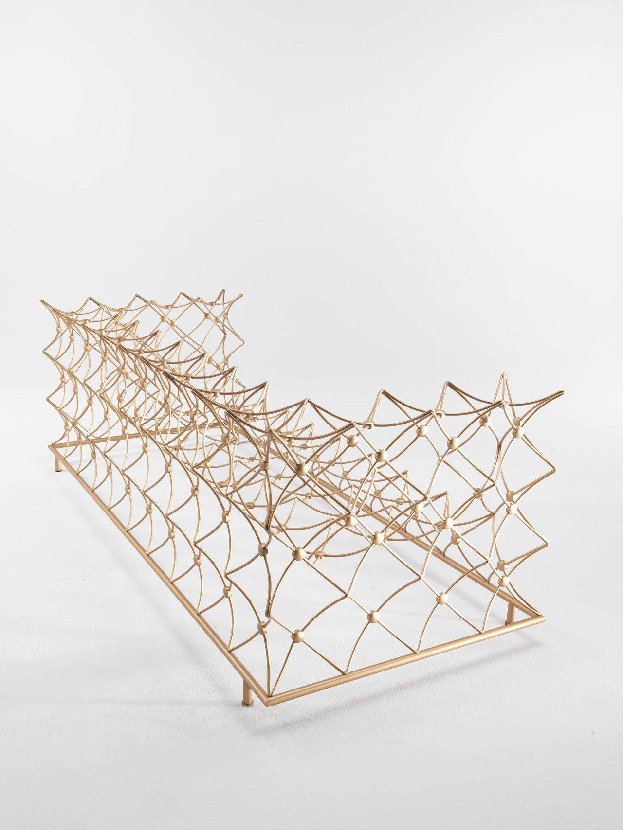 "ORAURO sofa by Emanuele Magini for JCP Universe.Materials: iron structure in ""tailor made"" gold finish.Dimensions (H x W x D): 85cm x 247cm x 100cm.Photo by Silvio Macchi © JCP Universe."